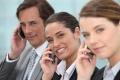 Three businesspeople on phone