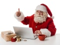 Santa Claus working with laptop on table Closeup Portrait. Isolated on White Background