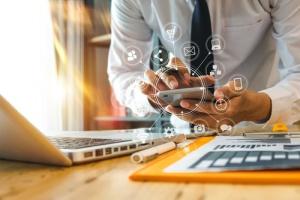 businessman or Designer using smart phone with laptop and digita